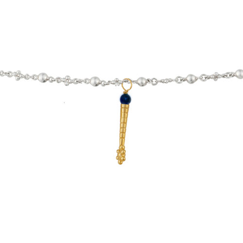 gold long charm with lapiz lazuli stone hanging on a silver bubble chain