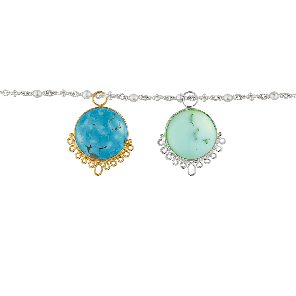 two colorful charmes hanging from chain. One with bright green crysophrase and the other with turquoise.
