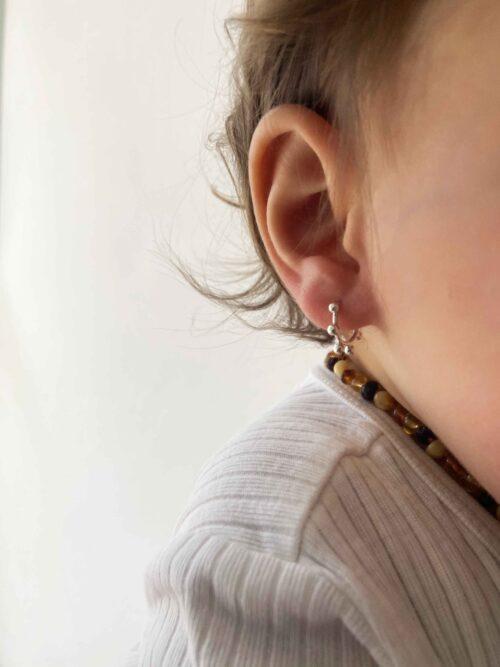 baby girl with little hoop earrings
