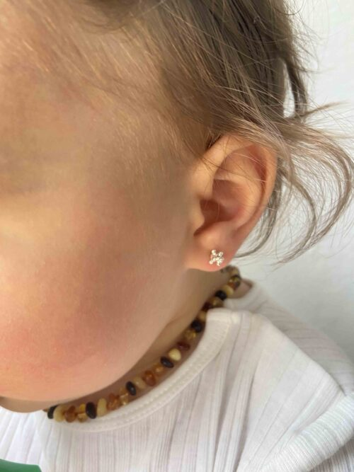 baby girl with little stud earrings